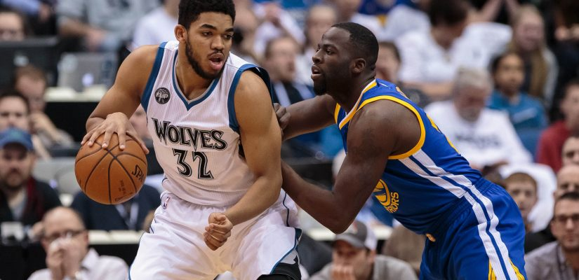 Mar 21, 2016; Minneapolis, MN, USA; Minnesota Timberwolves center Karl-Anthony Towns (32) dribbles in the first quarter against the Golden State Warriors forward Draymond Green (23) at Target Center. Mandatory Credit: Brad Rempel-USA TODAY Sports  / Reuters Picture Supplied by Action Images  (TAGS: Sport Basketball NBA) *** Local Caption *** 2016-03-22T004228Z_1194641487_NOCID_RTRMADP_3_NBA-GOLDEN-STATE-WARRIORS-AT-MINNESOTA-TIMBERWOLVES.JPG